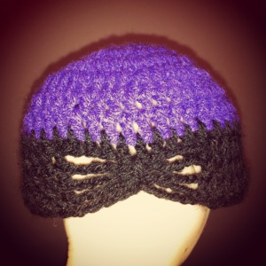 A purple and black Crochet hat